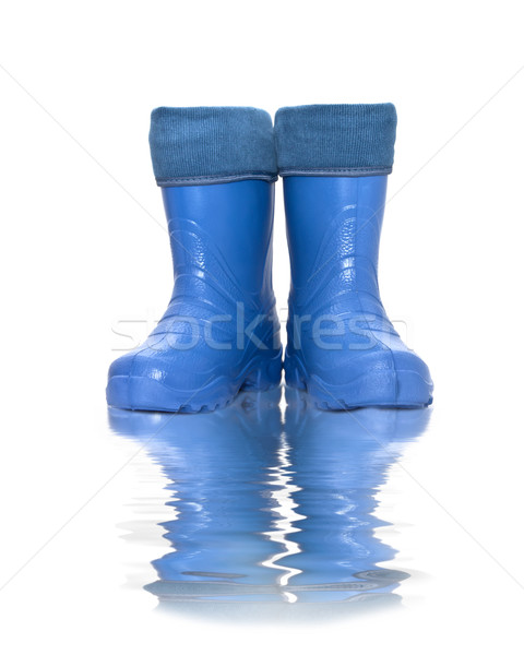 rubber boots  with reflection in water Stock photo © g215