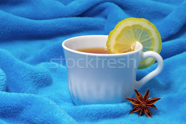 hot tea with lemon on a fur background Stock photo © g215