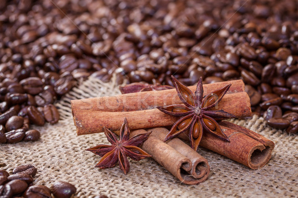 Cinnamon sticks and star anise on a background of coffee beans Stock photo © g215
