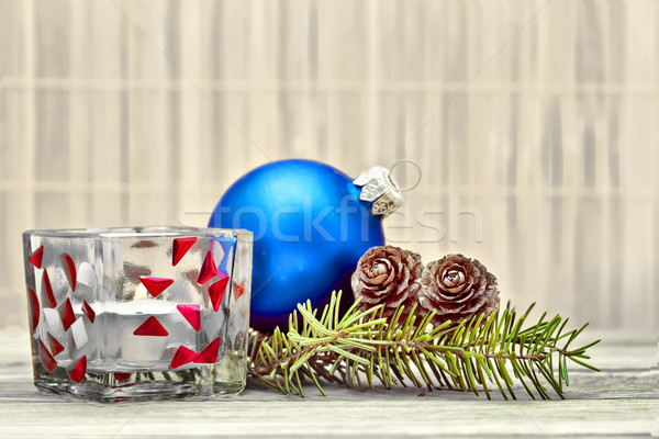 Pine branch with pine cones and Christmas decorations on a board background. Stock photo © g215
