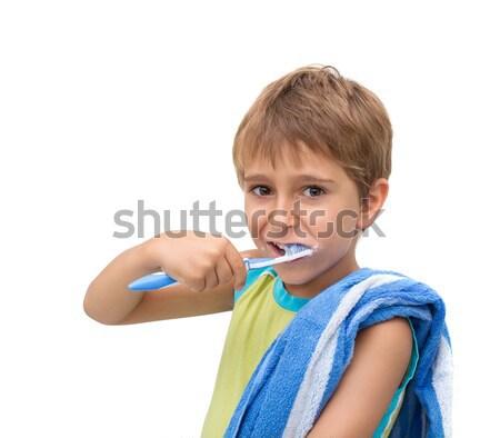 Kicsi fiú fogmosás kéz mosoly arc Stock fotó © g215