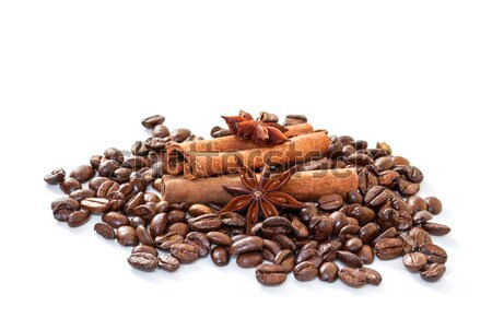 Cinnamon sticks and coffee beans on a white background. Stock photo © g215