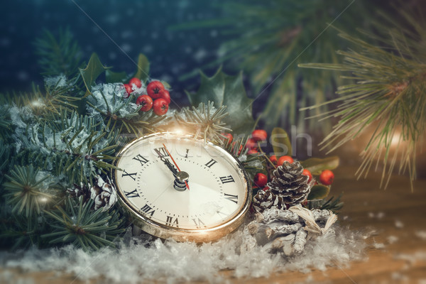 Christmas background with spruce and a clock. Stock photo © g215
