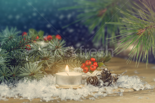 Christmas background with spruce and a burning candle. Stock photo © g215