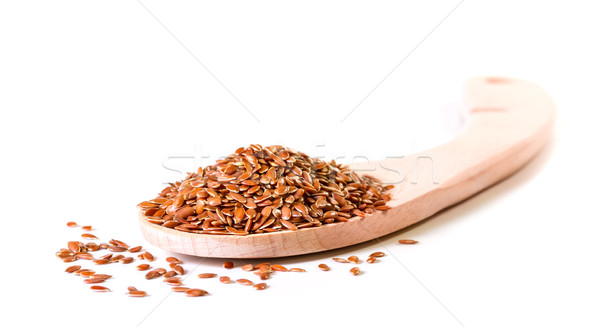 Brown flax seeds in wooden spoon on a white background Stock photo © g215