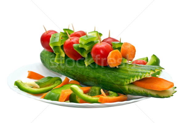Cucumber garnished with vegetables in the form of a crocodile Stock photo © g215