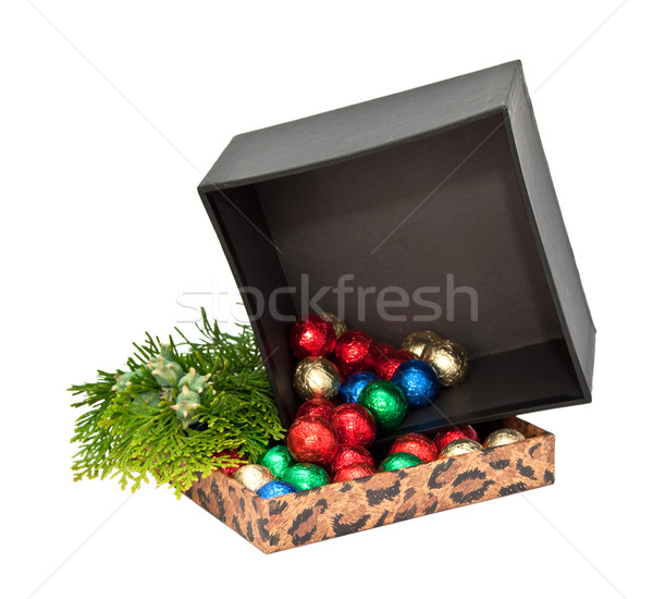 Gift box with balls of chocolate and a sprig of arborvitae. Stock photo © g215