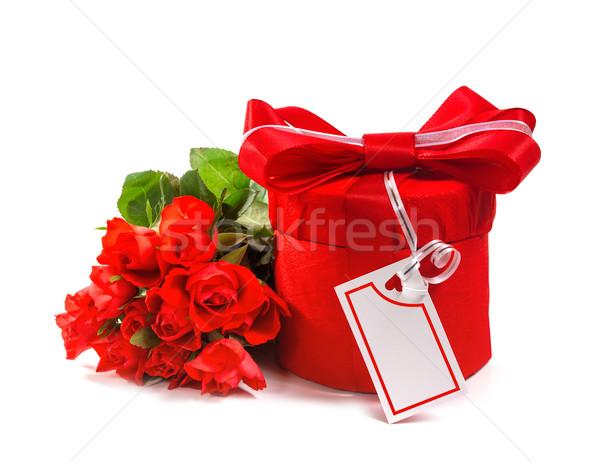 Piros ajándék íj rózsák izolált fehér Stock fotó © g215