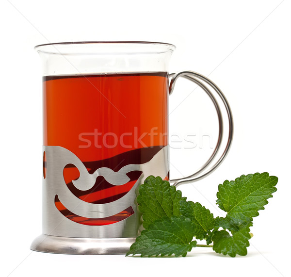 Tea in a glass holder and a sprig of lemon balm Stock photo © g215
