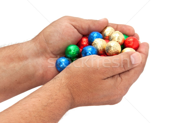 Shiny balls in the men's hands. Stock photo © g215