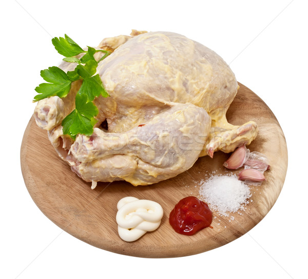 Raw chicken in the marinade on a white background  Stock photo © g215