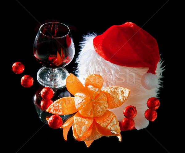 Gözlük şarap mandalina çikolata noel baba şapka Stok fotoğraf © g215