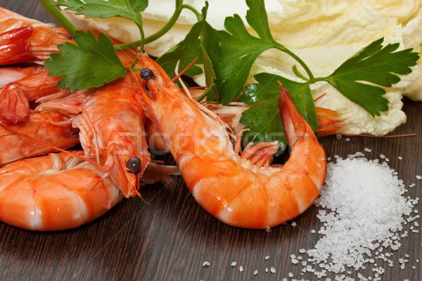 Prawns with a sprig of parsley and salad close up. Stock photo © g215