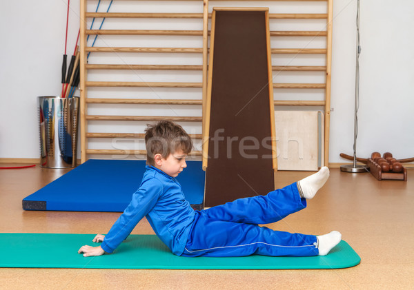 Stock photo: Child is therapeutic exercises in the gym