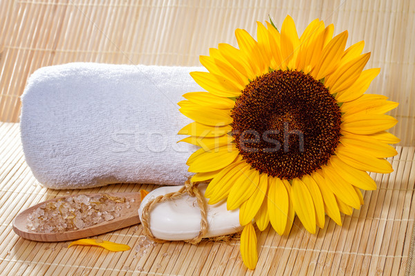 Spa background with natural soap, bath salts, and sunflower. Stock photo © g215