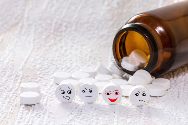 Tablets with smiley face in medical bottle Stock photo © g215