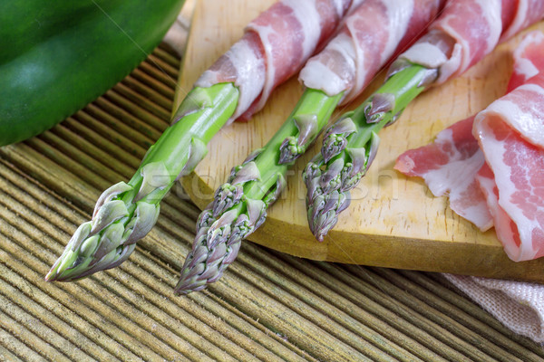 Bacon and asparagus on a wooden background  Stock photo © g215