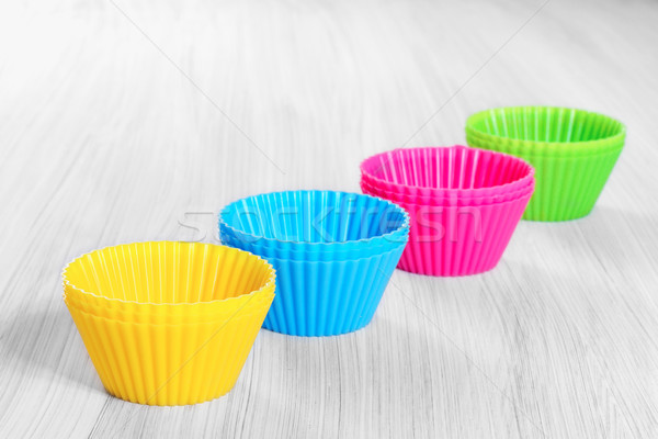 Colorful silicone baking cups on wooden background. Stock photo © g215