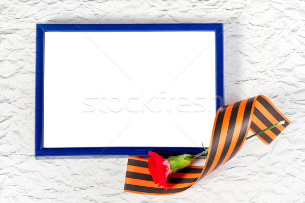 Photo frame with Red Carnation and St. George's ribbon Stock photo © g215