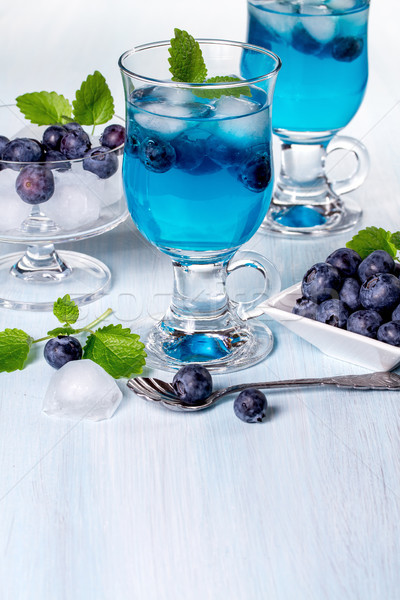 Alcoholic cocktail with blueberries and mint. Space for text Stock photo © g215
