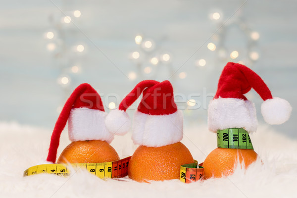 Christmas background with tangerines and measuring meter. Concep Stock photo © g215