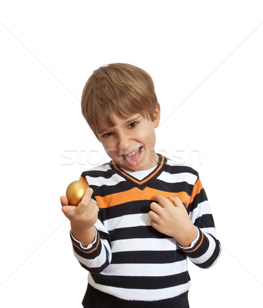 boy holding a golden egg, isolated on white background Stock photo © g215