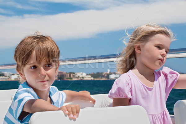 Boy and girl sailing on a yacht Stock photo © g215