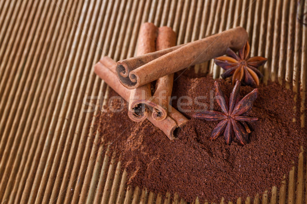 Ground coffee with cinnamon and star anise on a wooden backgroun Stock photo © g215