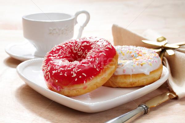 Delicious doughnut with confectioner's sugar. Stock photo © g215