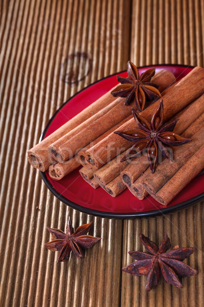 Cinnamon with anise on a wooden background Stock photo © g215