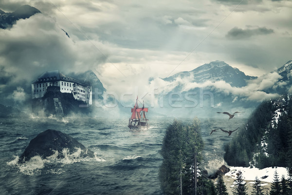 Mystical landscape with peaks of mountains and the sea. Stock photo © g215