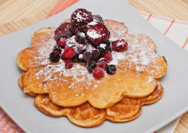 Wafers with berries and powdered sugar  Stock photo © g215