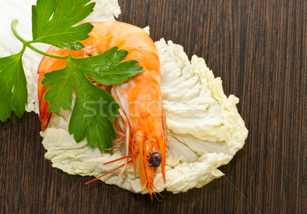 Prawn with a sprig of parsley and salad close up. Stock photo © g215