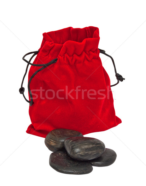Decorative stones in a red pouch isolated on white background. Stock photo © g215