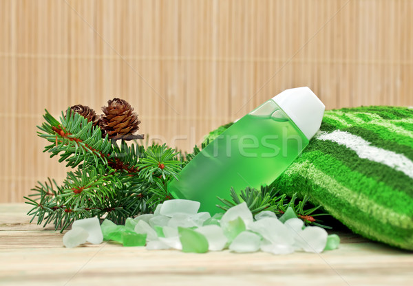 Coniferous extract bath with a sprig of pine needles, pine cones and bath salts. Stock photo © g215