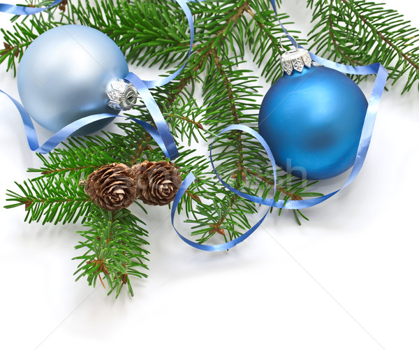 Pine branch with pine cones and Christmas decorations on a white background.  Stock photo © g215