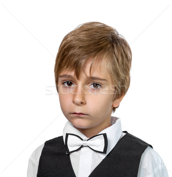 Portrait of a boy in a jacket with a bow tie. Stock photo © g215