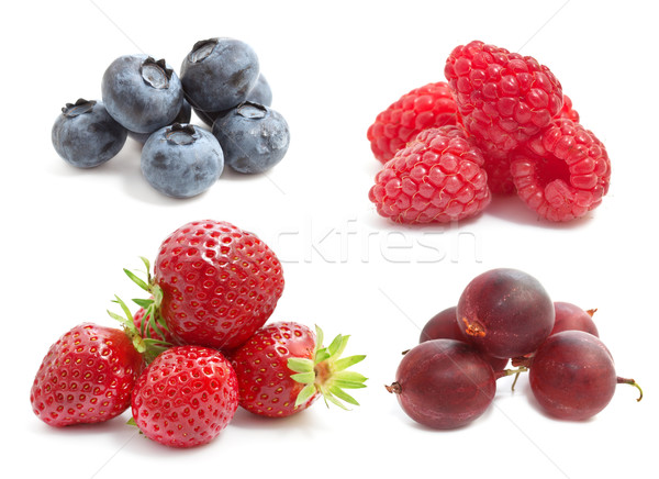 Summer berries on a white background: strawberries, raspberries, gooseberries, blueberries Stock photo © g215