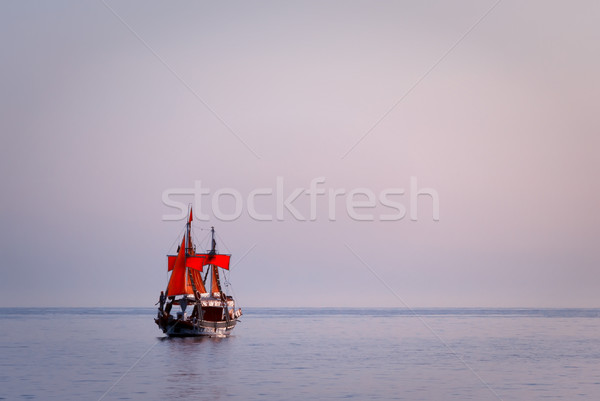 Ship with red sails in the sea Stock photo © g215