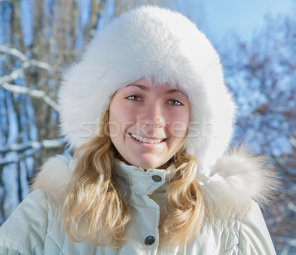 Girl in a fur hat  Stock photo © g215