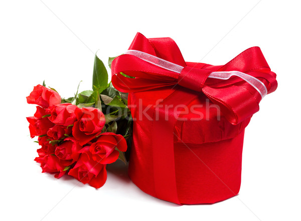 Red gift with a red bow and roses. Isolate on white background Stock photo © g215