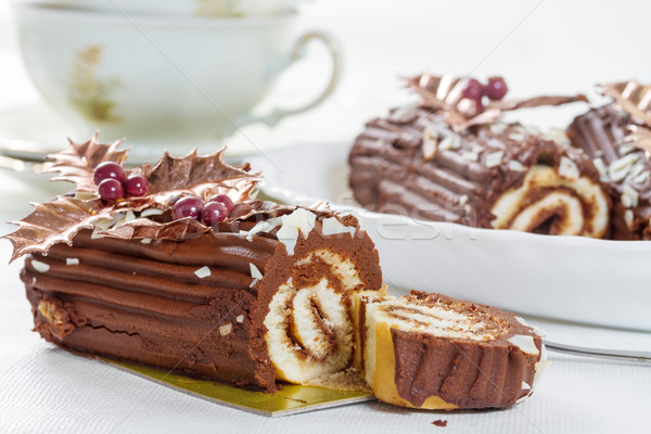 Chocolate roll with the decoration of leaves and berries Stock photo © g215