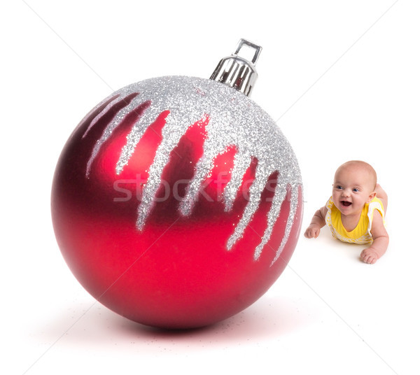 Cute Baby looking at a Huge Christmas Ornament on white Stock photo © gabes1976