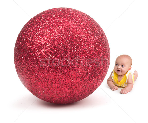 Cute Baby smiling at a Huge Christmas Ornament on white Stock photo © gabes1976