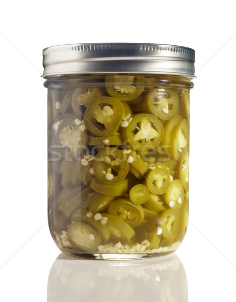Sliced Jalapenos (Capsicum Annuum) in a Glass Jar on White Stock photo © gabes1976