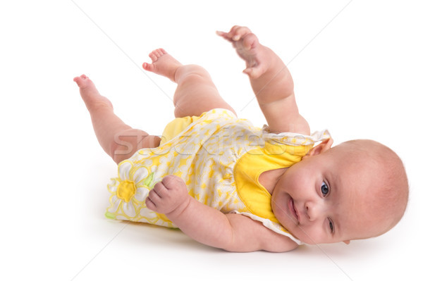 Cute baby rolling over isolated on white background Stock photo © gabes1976