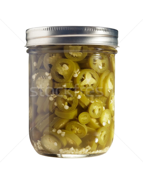 Sliced Jalapenos (Capsicum Annuum) in a Glass Jar Isolated on a White Background Stock photo © gabes1976