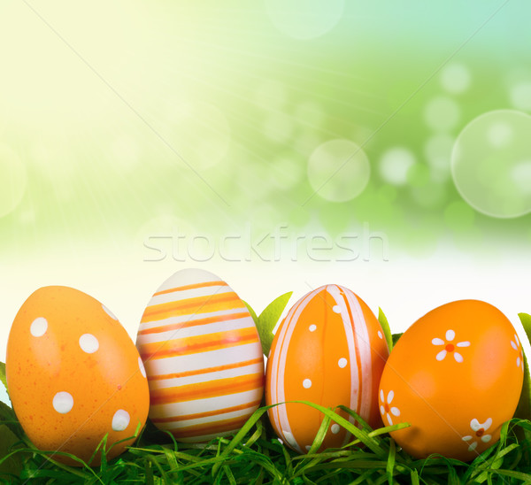 Easter eggs with spring background Stock photo © gabor_galovtsik