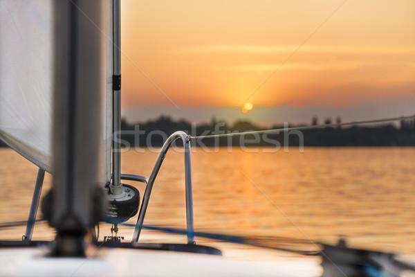 Voile coucher du soleil luxe yacht ciel nature Photo stock © gabor_galovtsik