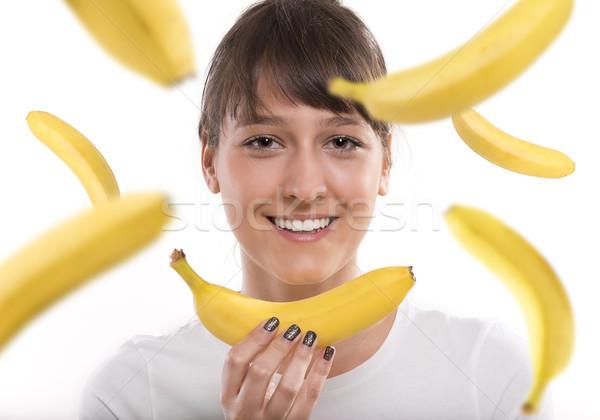 Bananes femme relevant isolé sourire Photo stock © gabor_galovtsik